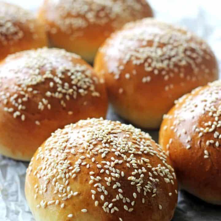 6 burger buns on a baking tray