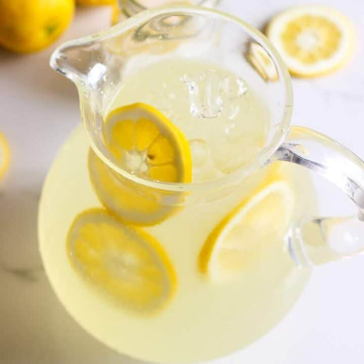 Pitcher of homemade lemonade on a white background