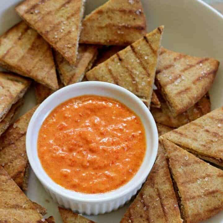 Roasted red pepper & feta dip....throw it together in 5 minutes and serve with super quick & easy pita chips!