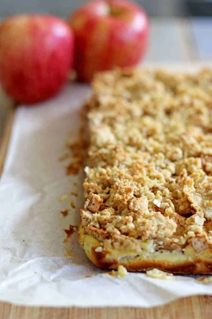 Buttery, spiced Apple Crumble Cheesecake Bars - the perfect autumn dessert and made even better drizzled with salted caramel sauce!