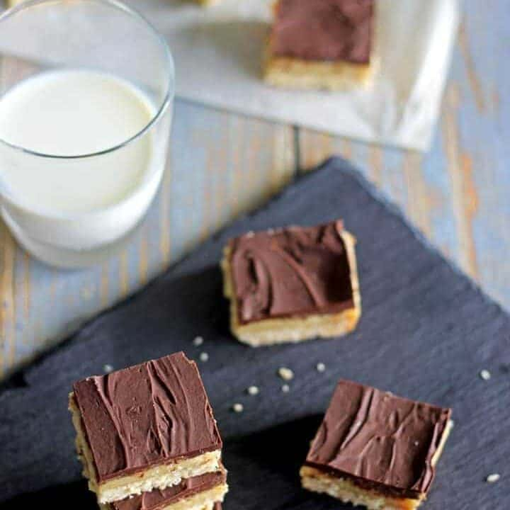 Triple layer chocolate caramel slice - coconut base, gooey caramel filling & dark chocolate topping