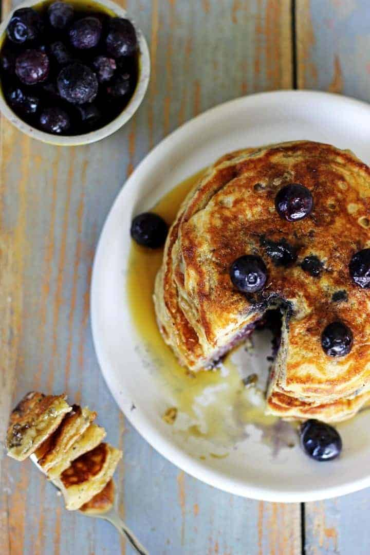 Best. Ever! Blueberry Buttermilk Pancakes.Soft, fluffy, full of blueberries and drizzled with maple syrup - the perfect breakfast! | Recipe at thekiwicountrygirl.com