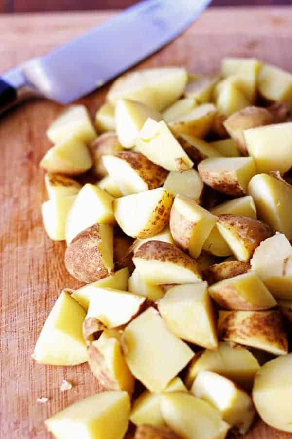 """Garlic, herb & parmesan fried potatoes are the perfect side dish. They'll be your new """"go-to"""" for potluck dinners, summer BBQ's and winter roasts! 