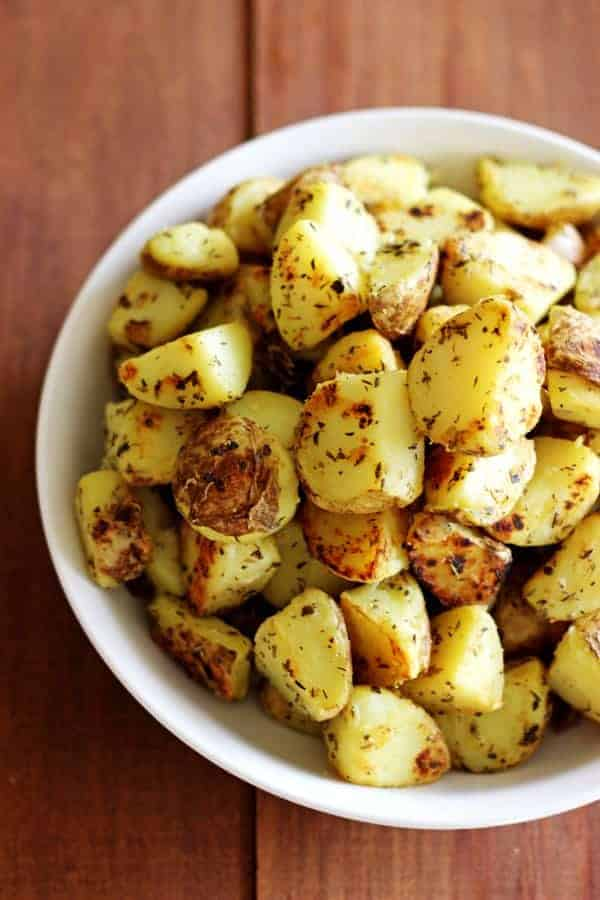 "Garlic, herb & parmesan fried potatoes are the perfect side dish. They'll be your new ""go-to"" for potluck dinners, summer BBQ's and winter roasts! 