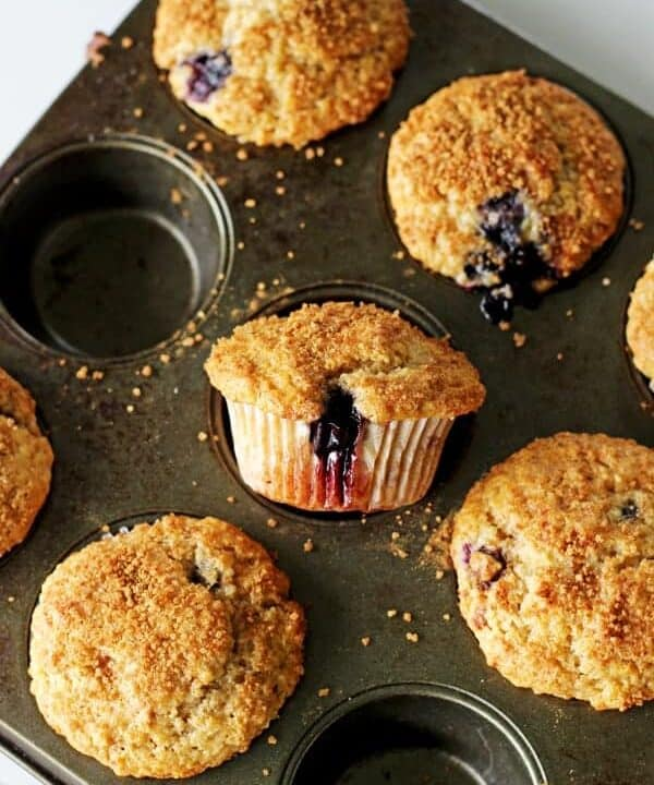 Crunchy Top Blueberry Muffins - my favourite master muffin base full of juicy blueberries, cinnamon and a crunchy sugary top - muffin perfection! | thekiwicountrygirl.com