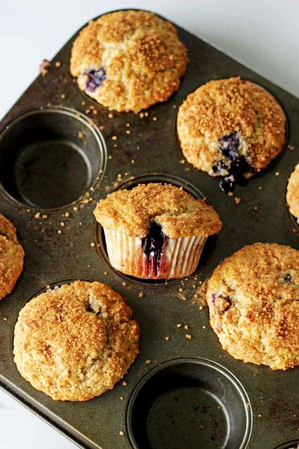 Crunchy Top Blueberry Muffins - my favourite master muffin base full of juicy blueberries, cinnamon and a crunchy sugary top - muffin perfection!   thekiwicountrygirl.com