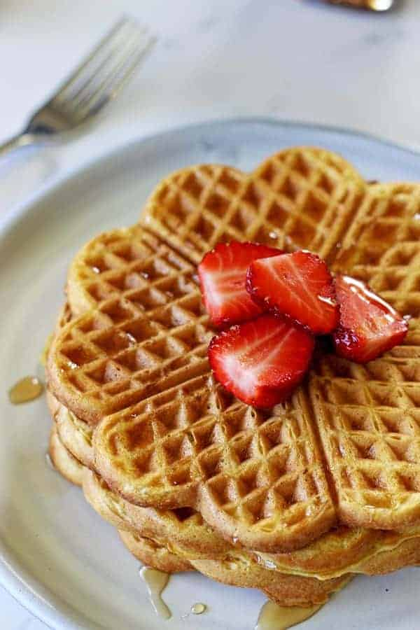 How all Sunday mornings should be spent - lazy starts, coffee and the best buttermilk waffles covered in maple syrup and fresh summer strawberries! | thekiwicountrygirl.com