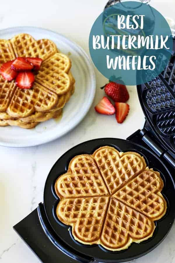 How all Sunday mornings should be spent - lazy starts, coffee and the best buttermilk waffles covered in maple syrup and fresh summer strawberries! #waffles #breakfast #brunch #easterbrunch | thekiwicountrygirl.com