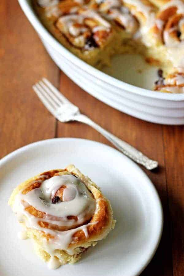 The perfect breakfast for Christmas morning - or any other time of year - soft, fluffy and sticky homemade cinnamon rolls with maple glaze! | thekiwicountrygirl.com