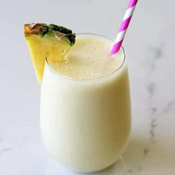 The best way to start getting excited for summer is with a pina colada smoothie - it's your favourite cocktail in healthy smoothie form! | thekiwicountrygirl.com