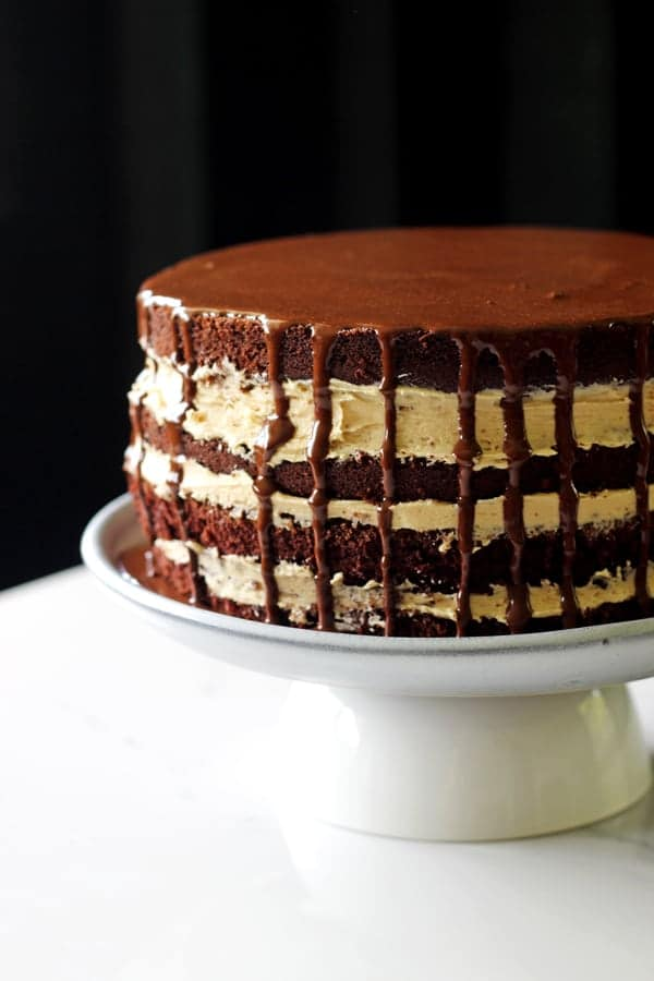 My favourite chocolate cake recipe teams up with salted caramel sauce and dark chocolate ganache to make the perfect salted caramel chocolate layer cake! | thekiwicountrygirl.com