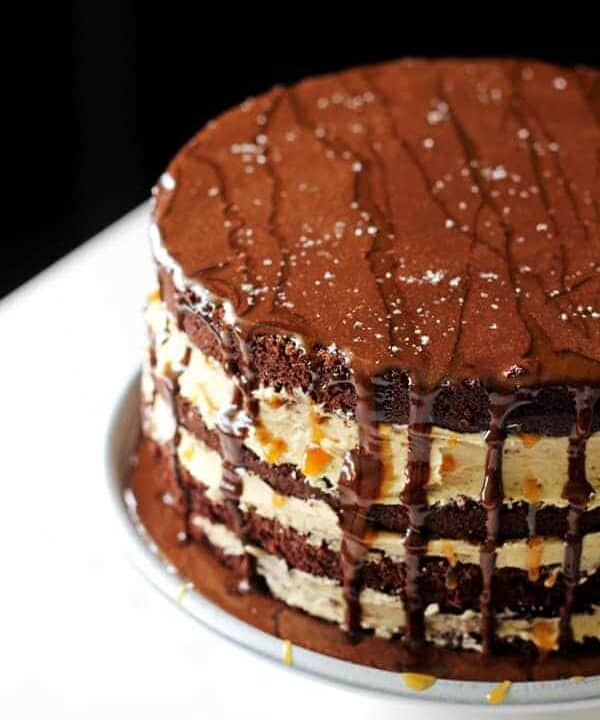 My favourite chocolate cake recipe teams up with salted caramel sauce and dark chocolate ganache to make the perfect salted caramel chocolate layer cake! | thekiwicountrygirl.com