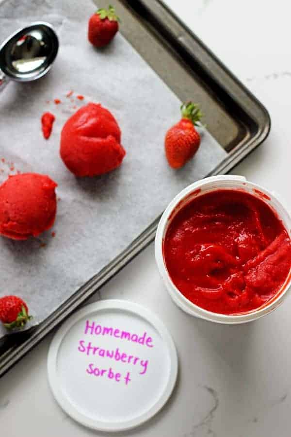Quick and easy homemade strawberry sorbet made with only 3 ingredients - fresh strawberries, sugar syrup and lemon juice. It's the perfect summertime treat! | thekiwicountrygirl.com