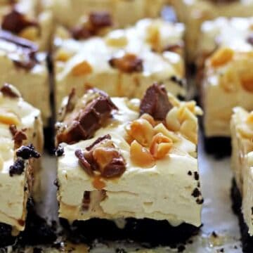 No Bake Snickers Cheesecake Bars - a new flavour of our favourite dessert, easy no bake cheesecake bars. Caramel, peanuts & cheesecake...dessert perfection! | thekiwicountrygirl.com