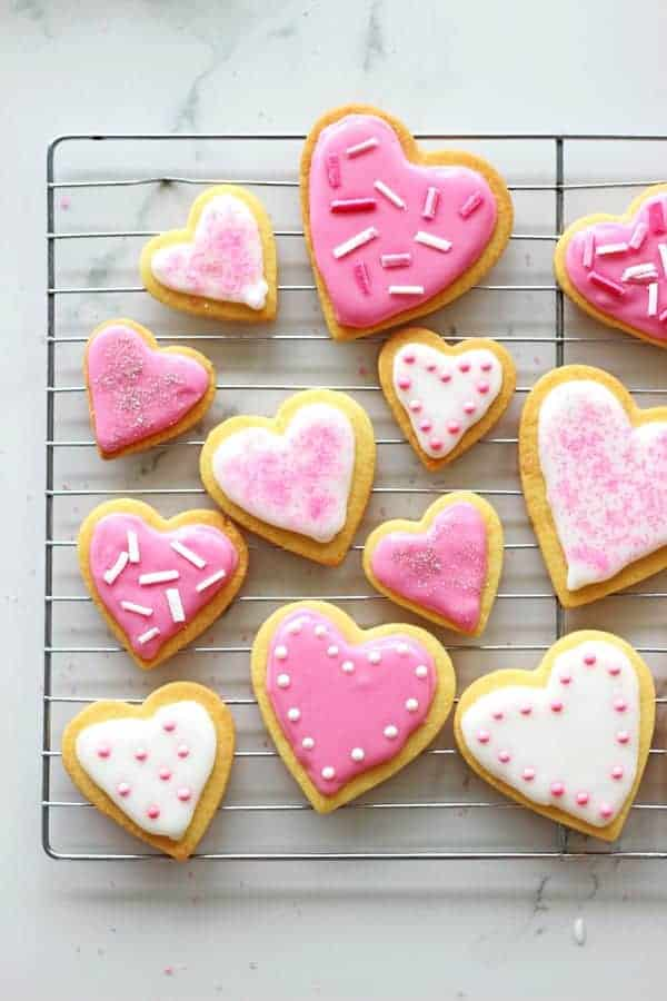 Valentine's Day Heart Sugar Cookies - the perfect cut out sugar cookies recipe and easy icing. Great for Valentine's Day, or any other day! | thekiwicountrygirl.com