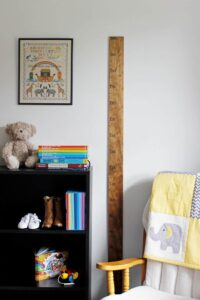 Toddler bedroom with bookshelf and DIY ruler growth chart on wall
