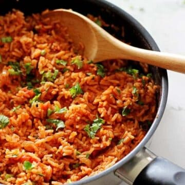 Mexican rice - the perfect quick & easy side dish to accompany any Mexican fiesta! Rice, onion, a few spices, tomatoes & fresh coriander. Delicious! | thekiwicountrygirl.com