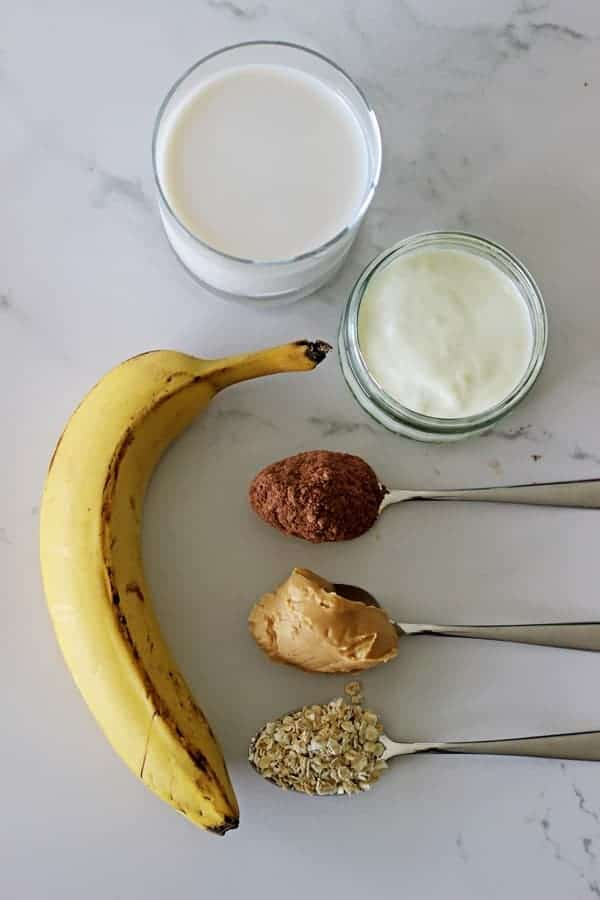 Peanut butter banana and chocolate breakfast smoothie! Creamy and delicious but totally healthy! The perfect breakfast, snack or guilt free dessert! | thekiwicountrygirl.com