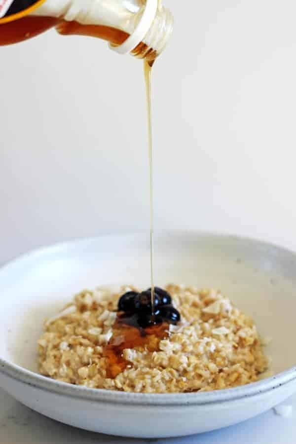 Coconut oatmeal - the perfect transitional breakfast from winter to summer. Tropical but still warm & cosy with lots of coconut flavour!   thekiwicountrygirl.com