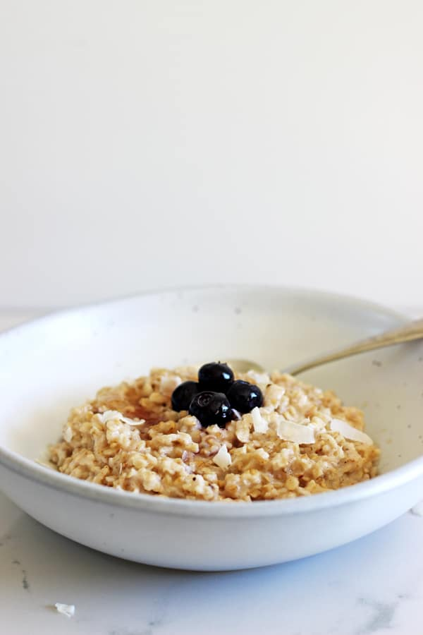 Coconut oatmeal - the perfect transitional breakfast from winter to summer. Tropical but still warm & cosy with lots of coconut flavour! | thekiwicountrygirl.com