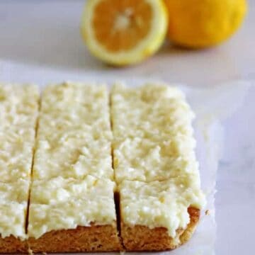 Lemon Coconut Slice - the perfect spring treat! A simple baked base topped with lemony coconut icing - keep it in the fridge for maximum deliciousness! | thekiwicountrygirl.com