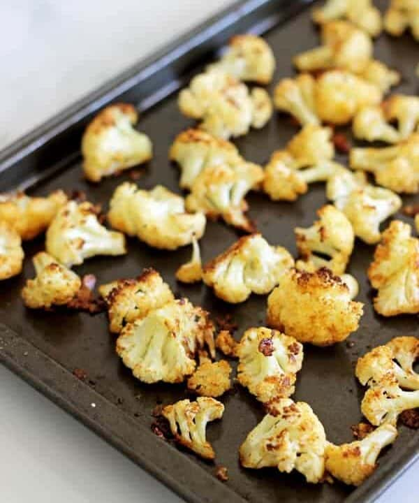 Parmesan Roasted Cauliflower - the perfect way to eat this delicious vegetable, cheesy, crispy and a great snack or side dish!   thekiwicountrygirl.com