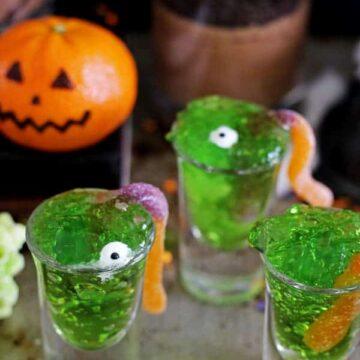 5 Quick and Easy Halloween Treats - jelly slime shots, monster popcorn slime balls, oreo graveyard cups, mandarin pumpkins & Halloween bark! | thekiwicountrygirl.com