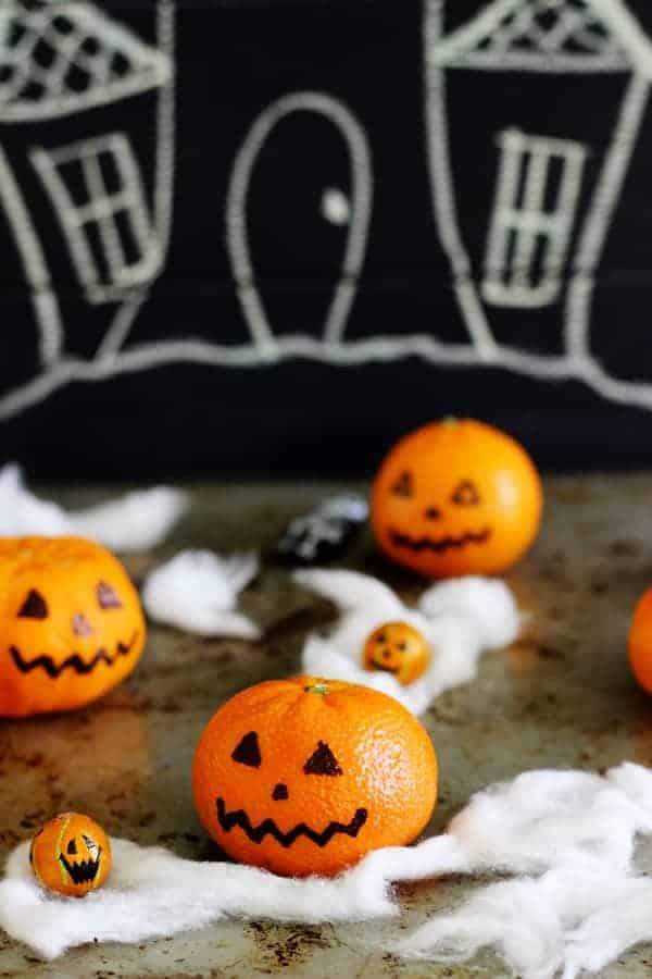 5 Quick and Easy Halloween Treats - jelly slime shots, monster popcorn slime balls, oreo graveyard cups, mandarin pumpkins & Halloween bark! | thekiwicountrygirl.com