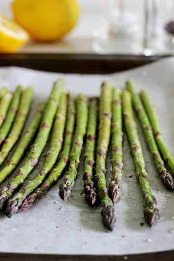 Lemon roasted asparagus - the perfect quick & easy side dish for early summer BBQ's. Ready in 20 minutes it's fresh, lemony and tastes like spring! | thekiwicountrygirl.com
