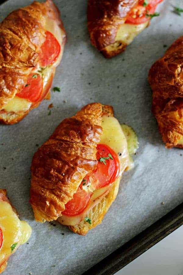 The easiest and tastiest 15 Minute Ham, Cheese & Tomato Croissants - they come together and are ready to eat in only 15 minutes! Perfect for Easter brunch or just any old weekend breakfast!   thekiwicountrygirl.com