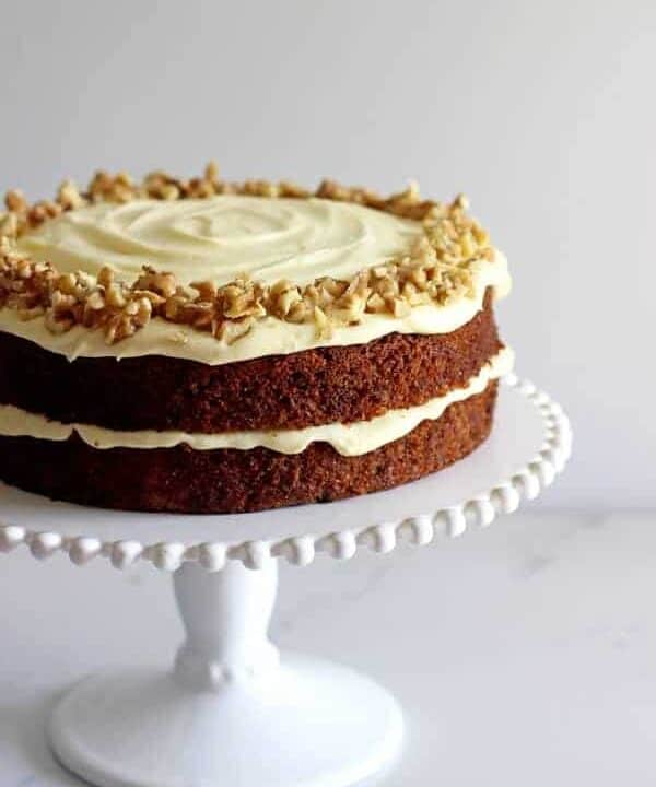 My all time favourite Carrot Cake recipe - loaded with grated carrot, crushed pineapple and crunchy walnuts and smothered in cream cheese frosting, this will become your favourite carrot cake recipe too! | thekiwicountrygirl.com