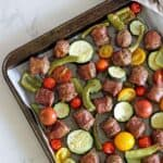 Sheet Pan Sausage & Veggies with Satay Sauce - a quick, easy and super tasty sheet pan dinner with colourful veggies, tasty sausages and a killer satay sauce! Great for weeknights and meal prep | thekiwicountrygirl.com