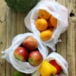 Reusable produce bags with apples mandarins and peppers
