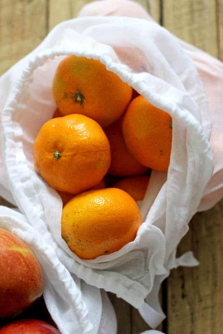 White muslin produce bag with mandarins