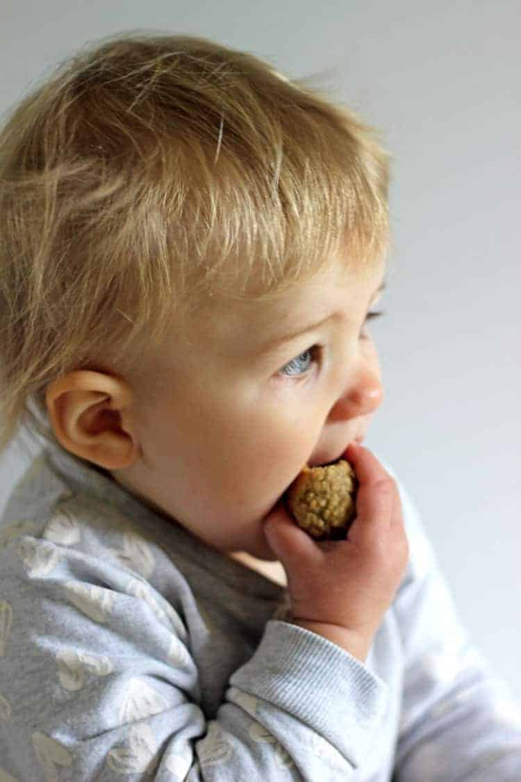 Baby eating banana muffin