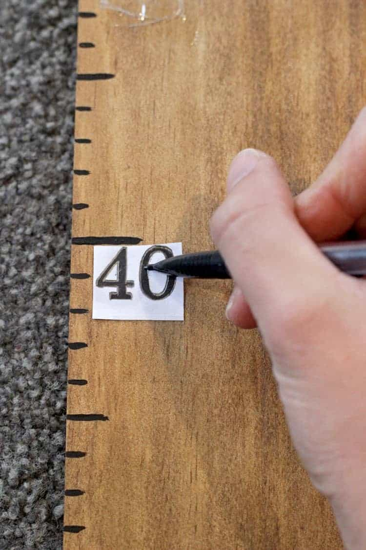 Wooden ruler growth chart with number 40