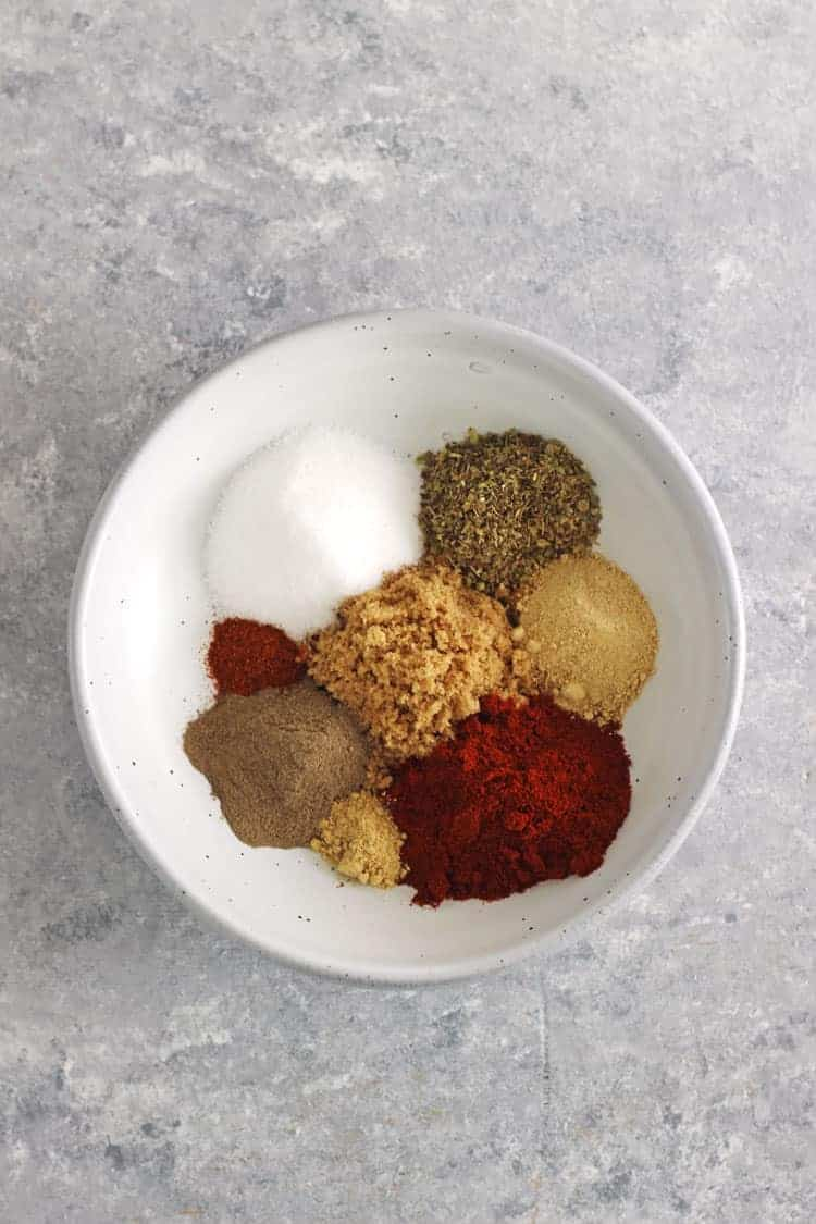 Bowl of spices for bbq spice rub on grey background