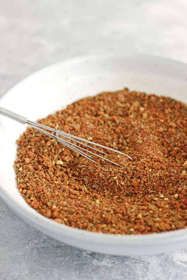 Bowl of bbq spice rub on grey background