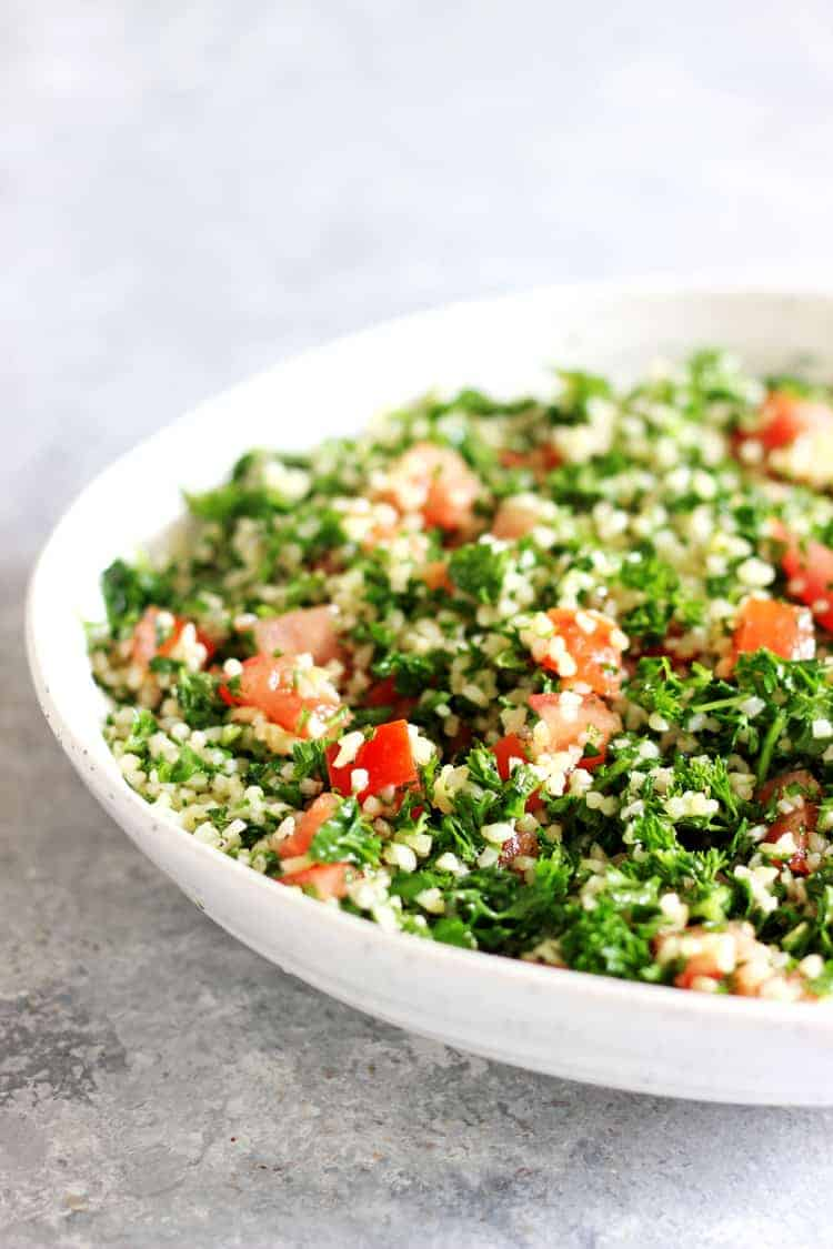 Tabbouleh Salad in a white bowl on a grey background