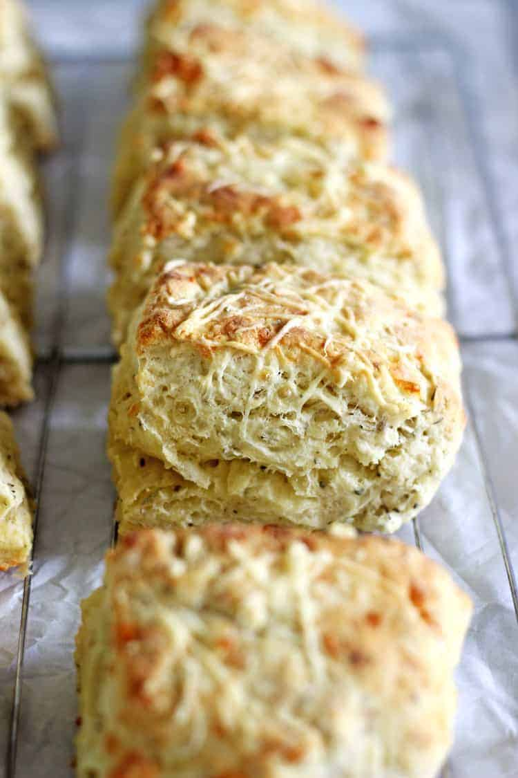 Freshly baked cheese scones on a cooling rack