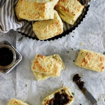 Overhead image of cheese and herb scones with onion chutney