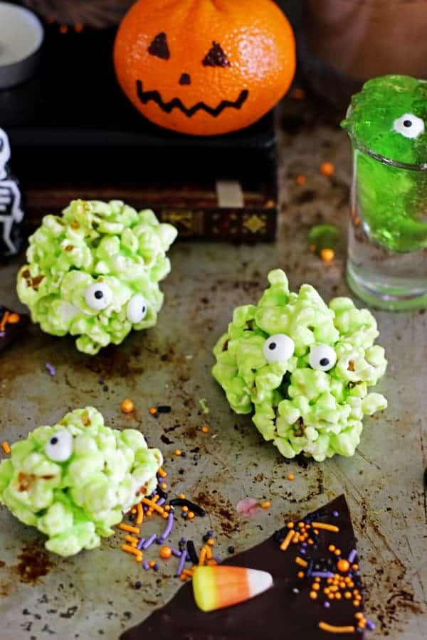 Green popcorn slime balls on a Halloween table