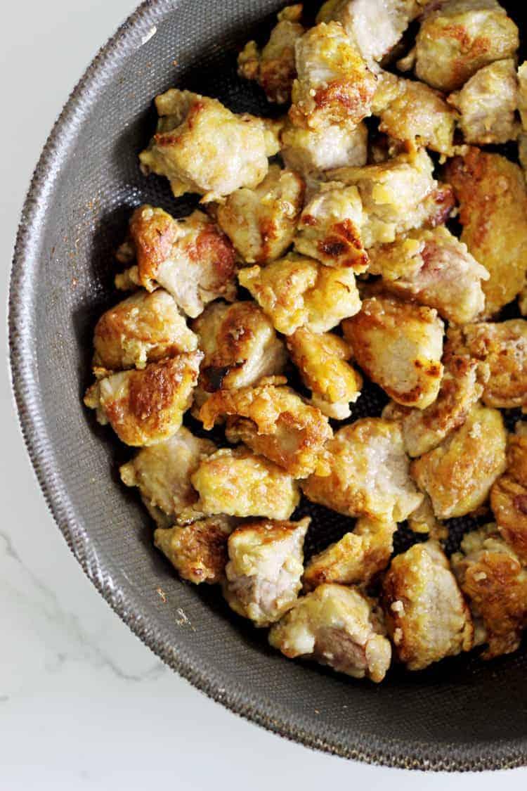 Crispy pork frying in pan