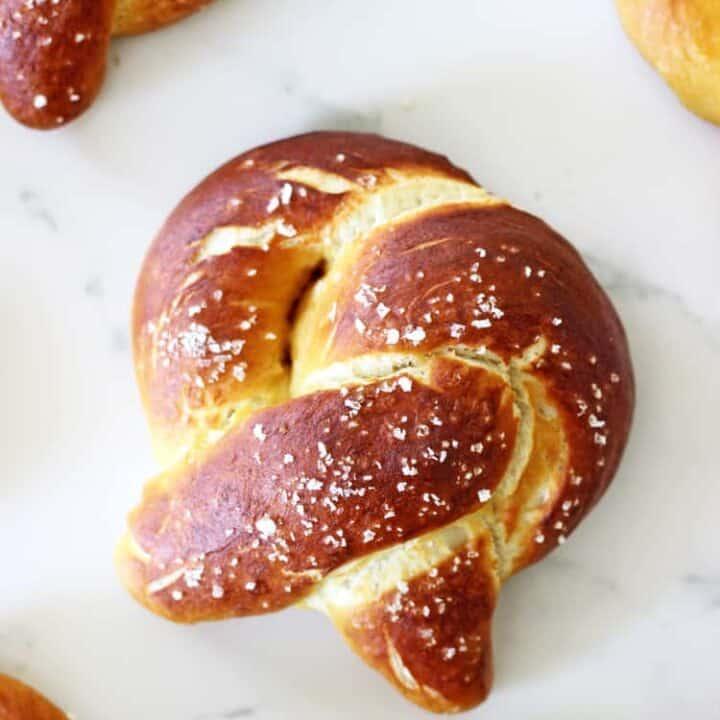 Overhead shot of homemade soft pretzel on white background