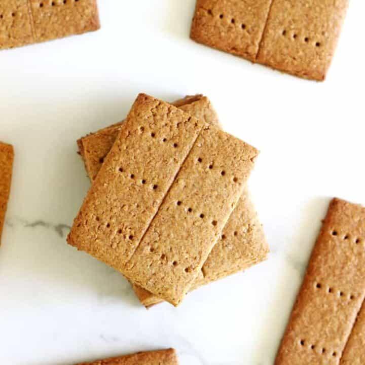 Homemade graham crackers on white marble background