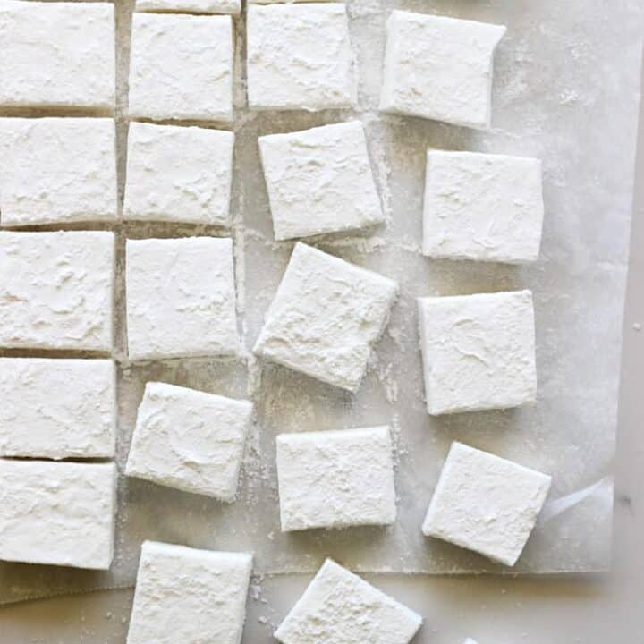Overhead of homemade marshmallows on a white background