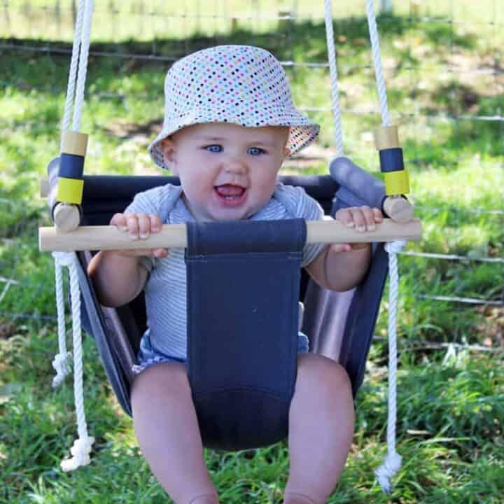 Baby swinging in handmade DIY baby swing