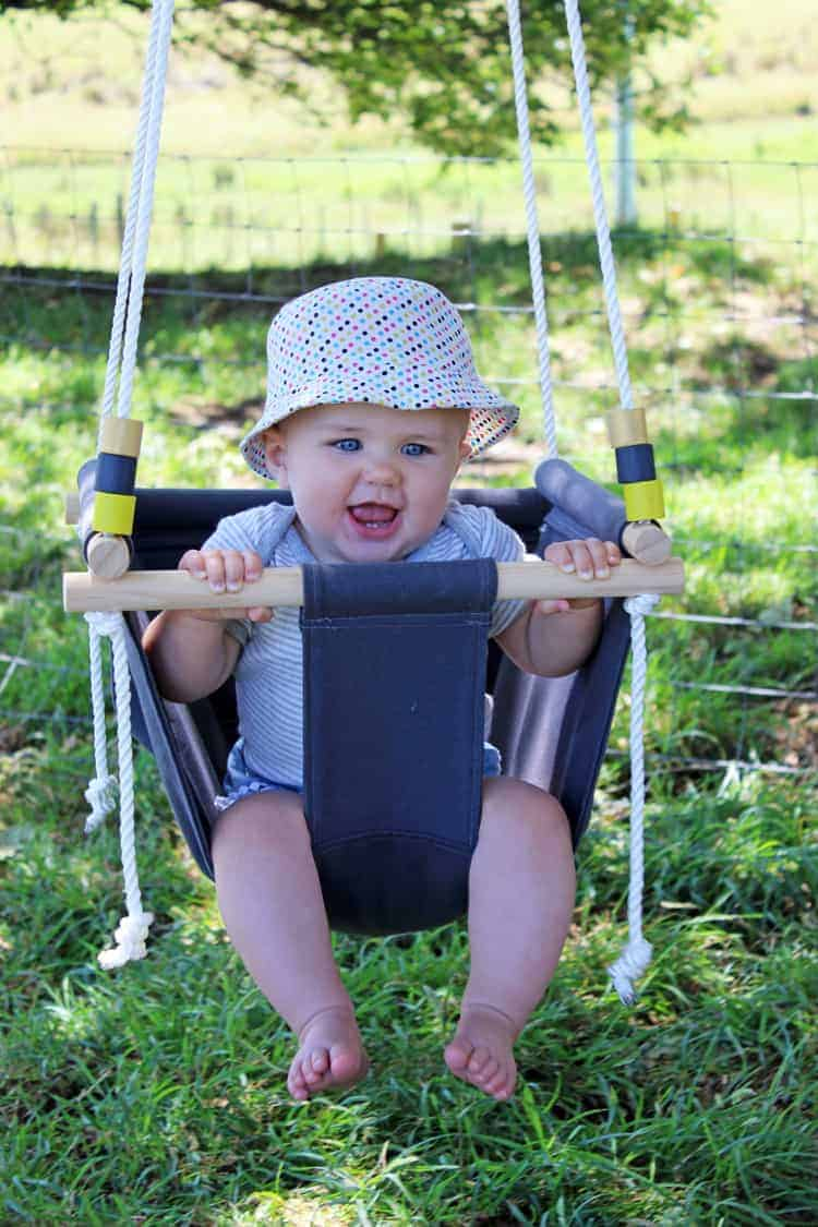 Baby swinging in handmade DIY baby swing