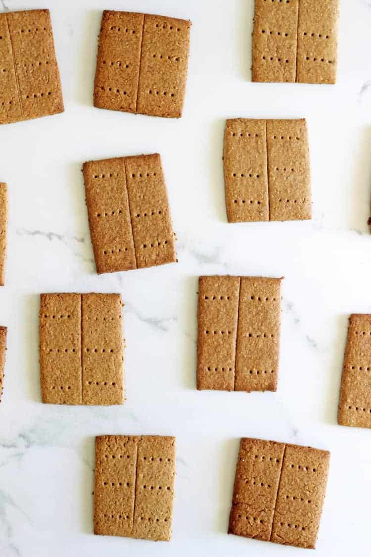 Homemade graham crackers on a white marble background