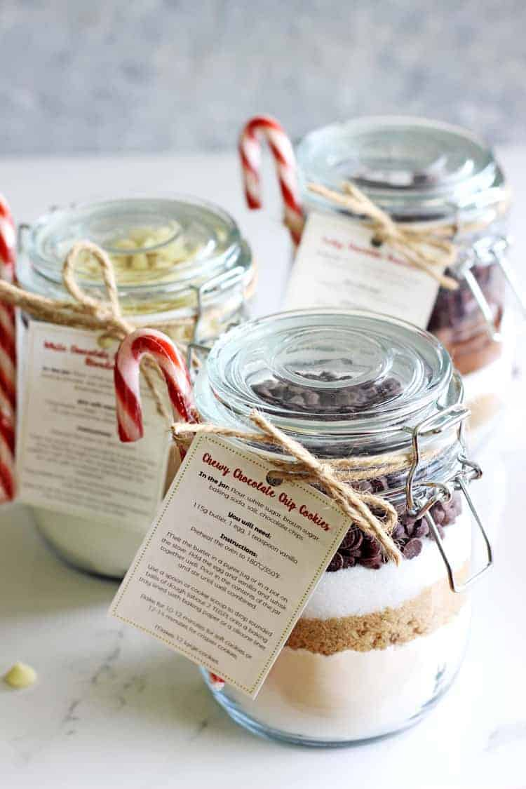 3 jars of homemade baking mixes with labels and candy canes as gift ideas